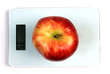 Red apple on scales