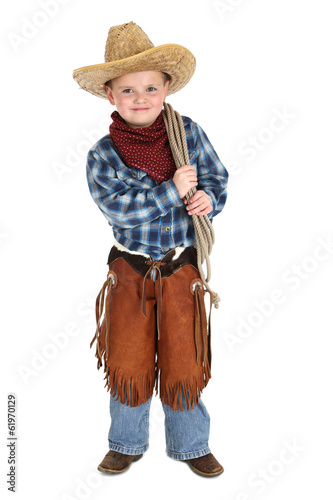 Spoed Foto op Canvas Boerderij Cute young cowboy stnading smiling holding a rope