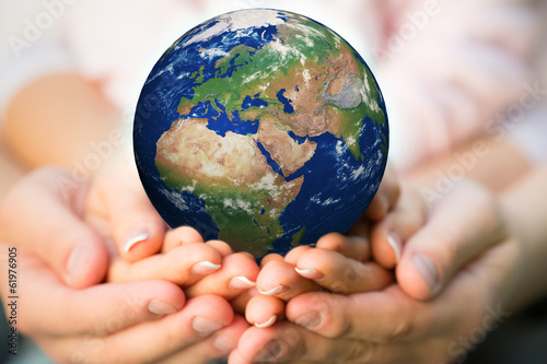 Family holding Earth planet