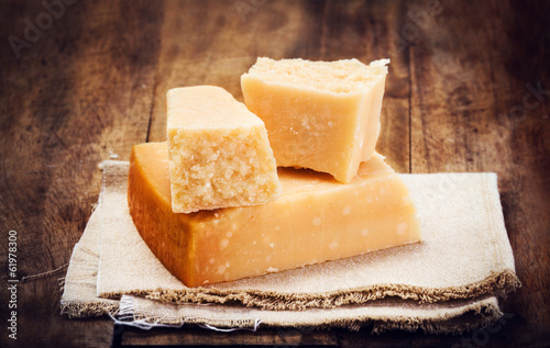 Fotografie, Obraz  Italian  Parmesan Cheese on Wooden Background close up. Piece of