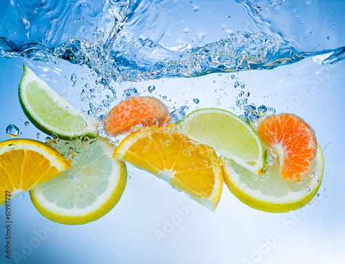 Fototapety, obrazy: Tropical fruits fall deeply under water with a big splash