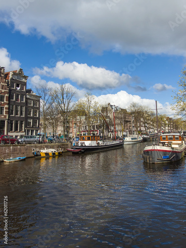 Photo  Amsterdam, Holland. Typical cityscape . Houseboat on the canal