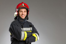 Cheerful Firefighter With Cros...