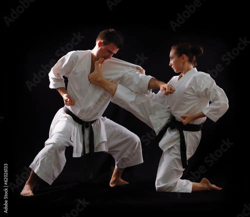 Obrazy Karate   fighting-karate-couple-man-and-woman-with-black-belts-champio