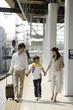 family walking along platform