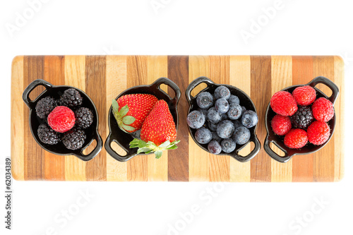 Ripe fresh autumn berries in separate dishes Canvas Print