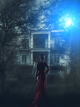 Woman In Red Dress At Haunted ...