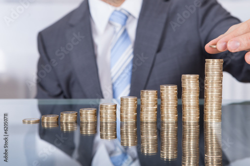 Fototapeta Businessperson With Stack Of Coins obraz