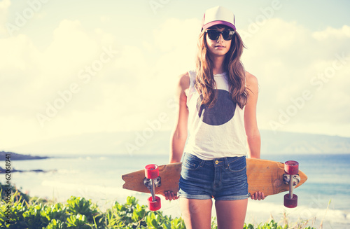 Fotografie, Obraz  Hipster girl with skate board wearing sunglasses