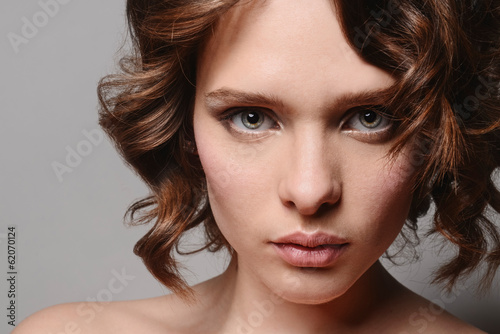 Photo  young beautiful girl with clean skin of the face. Pretty female