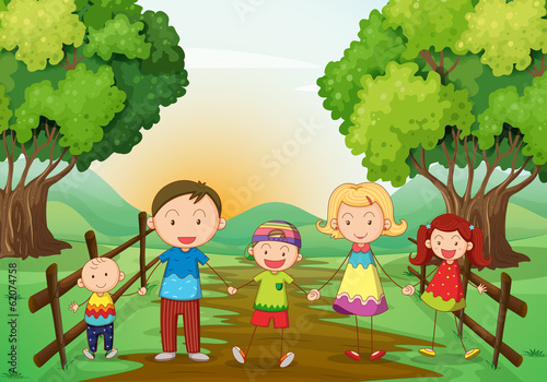 Canvas Prints Kids A happy family standing at the pathway
