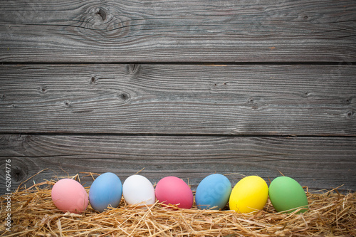 Photo  eater eggs on old wooden background
