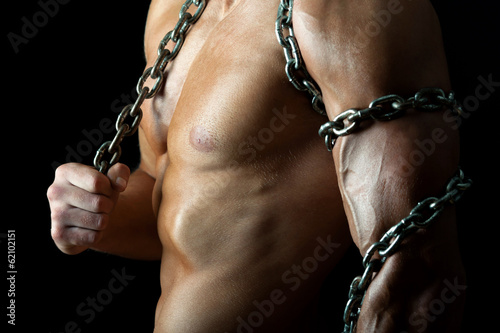 Fotografie, Obraz  Handsome and muscular guy with chain