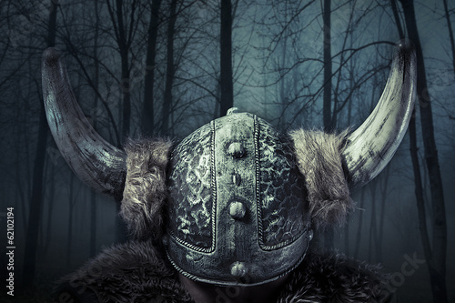 Photo  Helmet, Viking warrior, male dressed in Barbarian style with swo