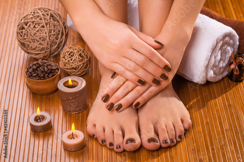 Canvas Prints Pedicure beautiful brown manicure and pedicure on the bamboo
