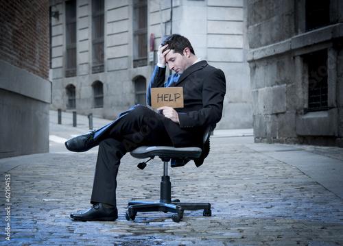 Fotografía  Business Man sitting on Office Chair on Street in stress
