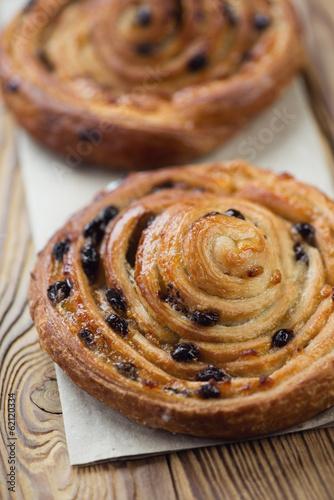 Foto op Plexiglas Bakkerij Sweet french roll buns, vertical shot, close-up