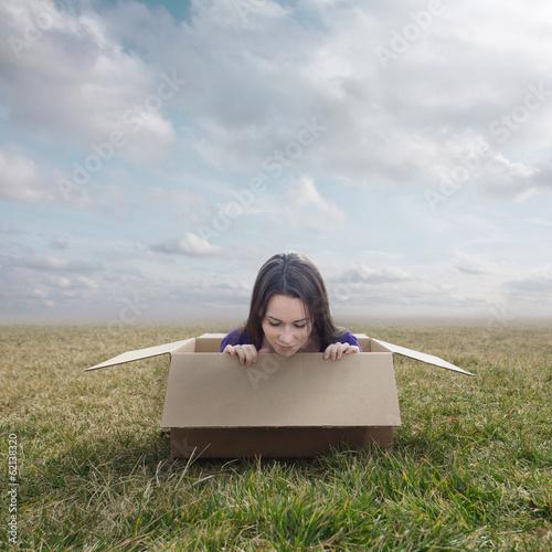 Fotografie, Obraz  Woman stuck in box