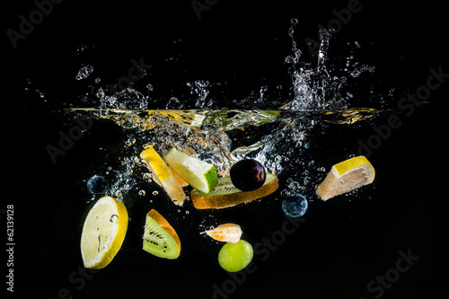 Splashing fruit on water.