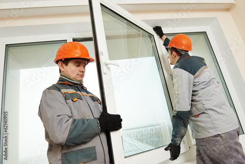 Fotografía  two workers installing window