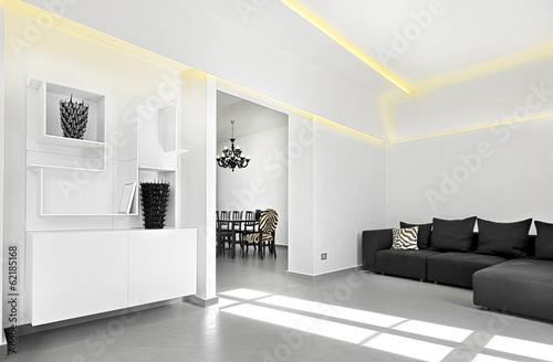 mobili bianchi e divano nel soggiorno moderno - Buy this ...