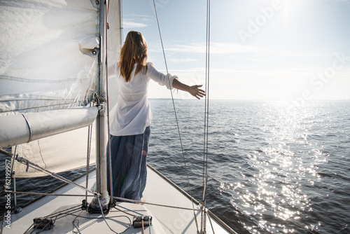 Tuinposter Zeilen woman staying on sailboat