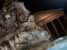 Fountain Of Piazza Rotonda At Night Outside Pantheon In Rome, It