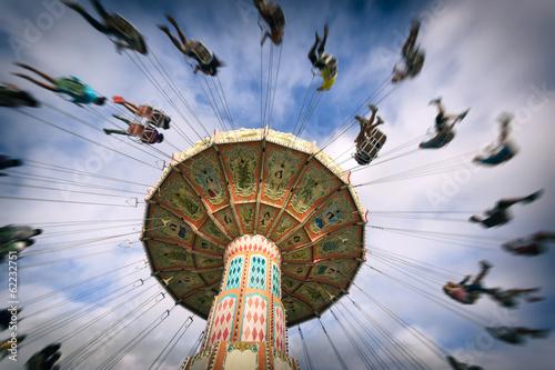 Amusement Park spinning vintage swing ride