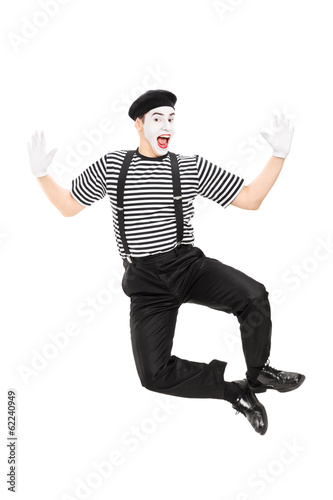 Obraz na plátně  Full length portrait of mime artist jumping with joy