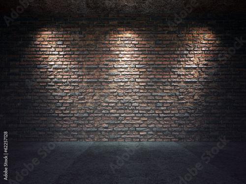 Foto op Plexiglas Wand Old brick wall illuminated by spotlights