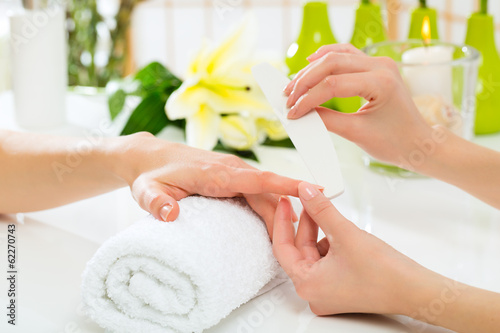 Printed kitchen splashbacks Manicure Woman in nail salon receiving manicure