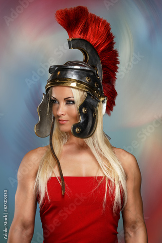 Gladiatrix in a shiny helmet with red feathers Canvas Print