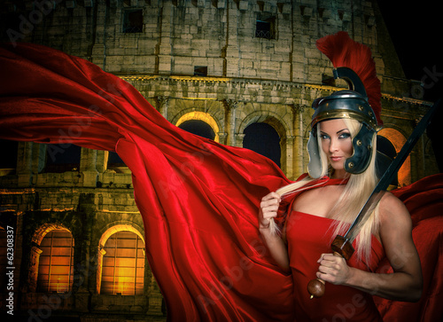 Fit blonde gladiatrix and Colossseum on the background Canvas Print