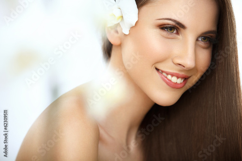 Fotografie, Obraz  Brown Hair. Portrait of Beautiful Woman with Long Hair. Face