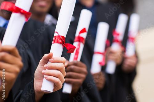 group of graduates holding diploma Canvas Print