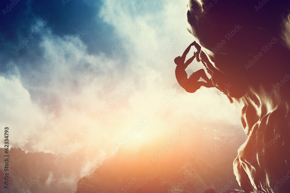 Fototapety, obrazy: A silhouette of man climbing on rock, mountain at sunset.
