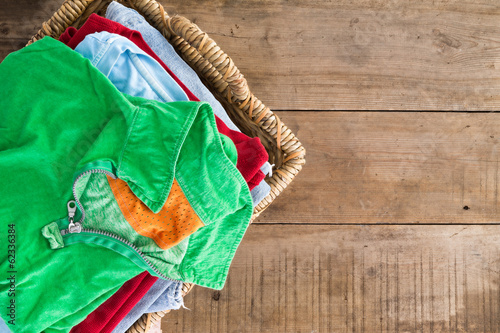 Fotografie, Obraz  Clean unironed summer clothes in a laundry basket