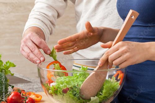 Fotografie, Obraz  Mixing salad