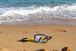 Swimming mask on sea beach