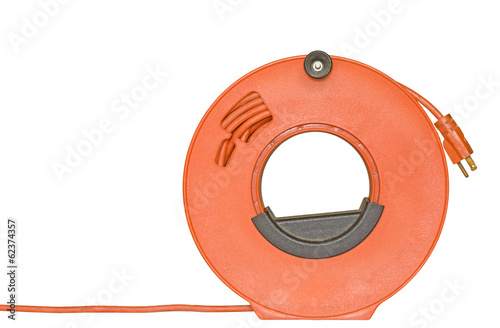 Fotografie, Obraz  Power cord extension plug on orange plastic reel.