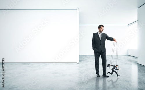 Fotografie, Obraz  boss with his marionette