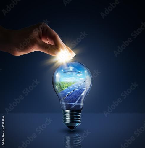 Fototapeta invest in solar energy -  concept - sun in bulb - piggybank obraz