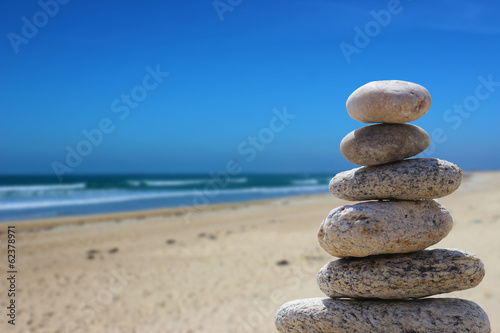Photo Stands Stones in Sand zen balance stone on the beach 5