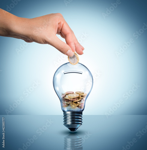 Obraz invest to energy concept - euro in bulb - piggybank - fototapety do salonu