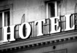 Hotel logo in black and white on a vintage building