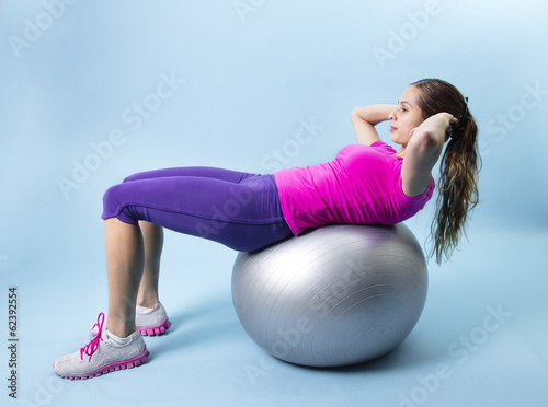 Valokuva  Fitness Woman abdominal exercise