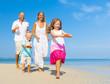Family Running on the Beach