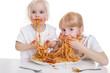 canvas print picture - zwei Mädchen essen Spaghetti