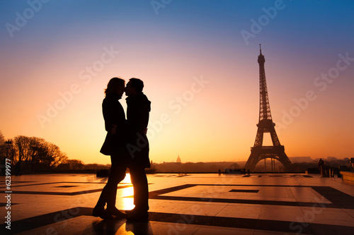 loving couple kissing on Eiffel Tower background, Paris, France