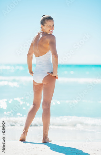 Recess Fitting Gymnastics Full length portrait of young woman standing on beach
